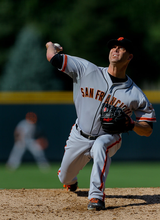 . Starting pitcher Tim Hudson #17 of the San Francisco Giants delivers to home plate during the first inning against the Colorado Rockies at Coors Field on September 1, 2014 in Denver, Colorado. (Photo by Justin Edmonds/Getty Images)