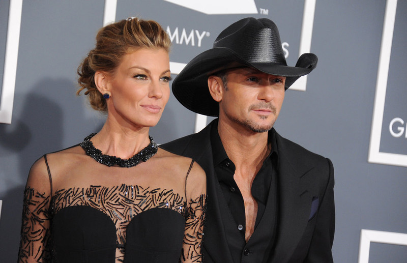 . Faith Hill, left, and Tim McGraw arrive at the 55th annual Grammy Awards on Sunday, Feb. 10, 2013, in Los Angeles.  (Photo by Jordan Strauss/Invision/AP)