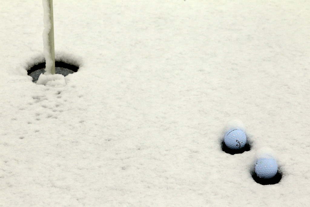 . MARANA, AZ - FEBRUARY 20:  Golf balls are seen in the snow on the practice putting green as play was suspended due to weather during the first round of the World Golf Championships - Accenture Match Play at the Golf Club at Dove Mountain on February 20, 2013 in Marana, Arizona.  (Photo by Jed Jacobsohn/Getty Images)