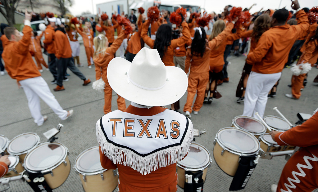 . The Texas band plays as the football team arrives for the Valero Alamo Bowl NCAA college football game against the Oregon, Monday,  Dec. 30, 2013, in San Antonio. (AP Photo/Eric Gay)