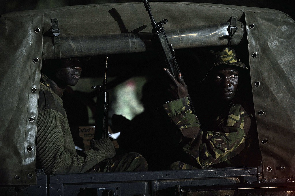 ". Kenyan paramilitaries drive towards the Westgate mall on September 24, 2013 in Nairobi. Kenyan President Uhuru Kenyatta announced today that the four-day siege by Islamist gunmen of a Nairobi shopping mall was over, with the ""immense\"" loss of 61 civilians and six members of the security forces. SIMON MAINA/AFP/Getty Images"