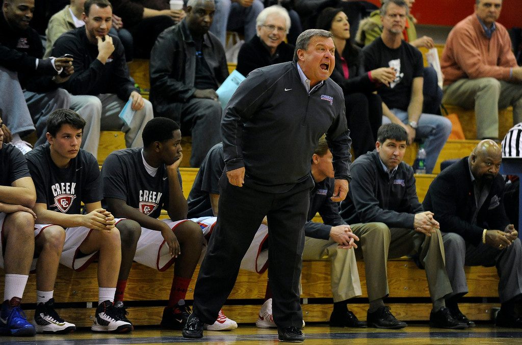 . GREENWOOD VILLAGE, CO. - FEBRUARY 13: Cherry Creek head coach Mike Brookhart shouts instructions to his team in the first half Wednesday night at Cherry Creek High School. (Photo by Steve Nehf, The Denver Post)