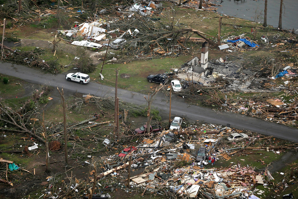 . A Highway Police car patrols a neighborhood in Mayflower, Ark., Monday, April 28, 2014, after a tornado struck the town late Sunday, killing at least 17 people.   (AP Photo/Danny Johnston)