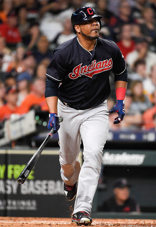 . Cleveland Indians designated hitter Edwin Encarnacion watches his solo home run off Houston Astros starting pitcher Charlie Morton during the seventh inning of a baseball game Friday, May 18, 2018, in Houston. (AP Photo/Eric Christian Smith)