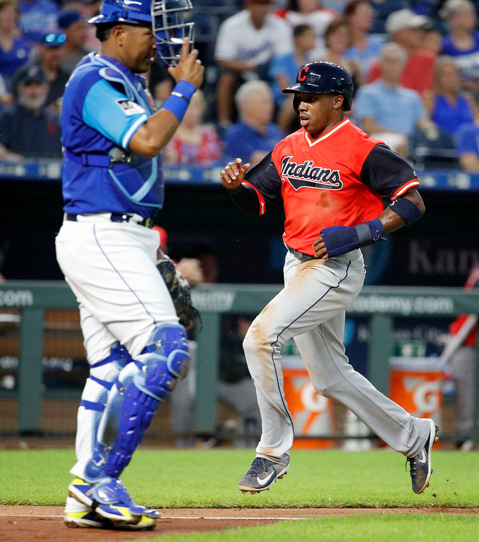 . Cleveland Indians\' Greg Allen crosses the plate past Kansas City Royals catcher Salvador Perez as he scores on a single by Michael Brantley during the third inning of a baseball game Friday, Aug. 24, 2018, in Kansas City, Mo. (AP Photo/Charlie Riedel)