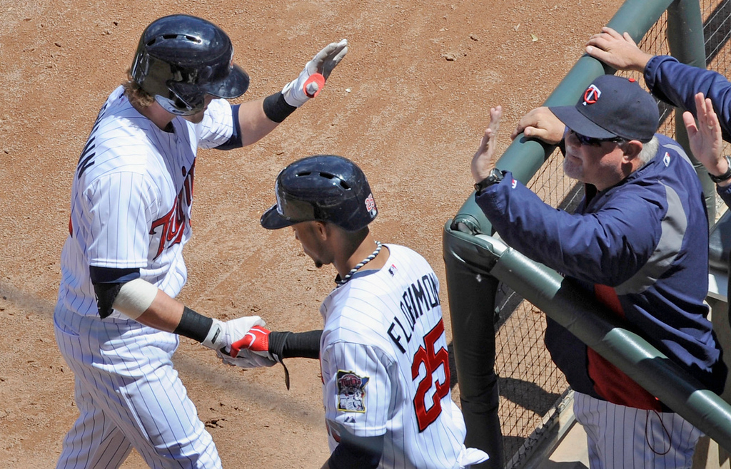 . Minnesota\'s Chris Herrmann, left, celebrates his first home run of the season, a fourth inning solo shot, with teammate Pedro Florimon, against the Mariners. (Photo by Hannah Foslien/Getty Images)