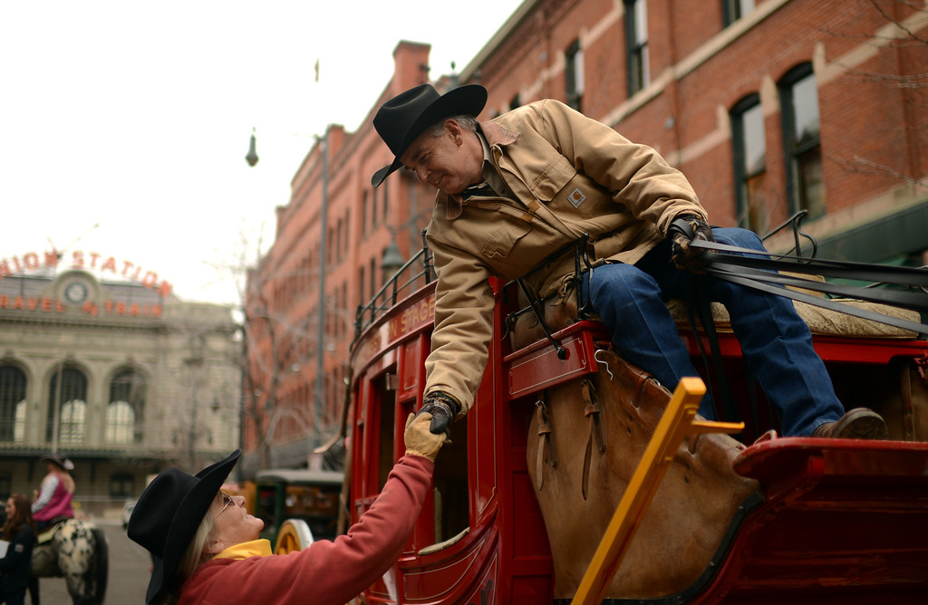 . Cindy Orr, left, and Scott Smith celebrate 107th National Western Stock Show Kick-Off Parade at Downtown Denver on Thursday, Denver, CO, January 10, 2013.  Hyoung Chang, The Denver Post