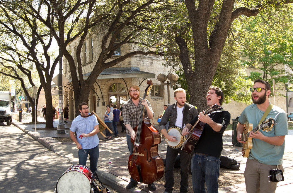 . In this Wednesday, March 13, 2013 photo, Jared & The Mill perform on Sixth Street during South by Southwest in Austin, Texas. (AP Photo/Austin American-Statesman, Jay Janner)