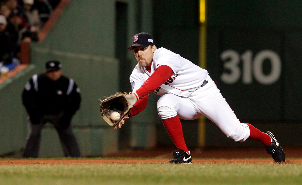 . Boston Red Sox third baseman Bill Mueller catches a line drive hit off the bat of St. Louis Cardinals\' Mike Matheny during the second inning of Game 2 of the World Series in Boston, Sunday, Oct. 24, 2004. Mueller turned a double play by tagging Cardinals\' Reggie Sanders out at third base.  (AP Photo/Elise Amendola)