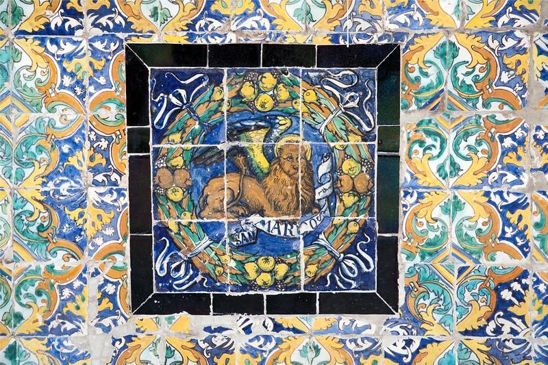 Saint Mark symbol on old glazed ceramic tiles, Fine Arts Museum, Seville, Spain