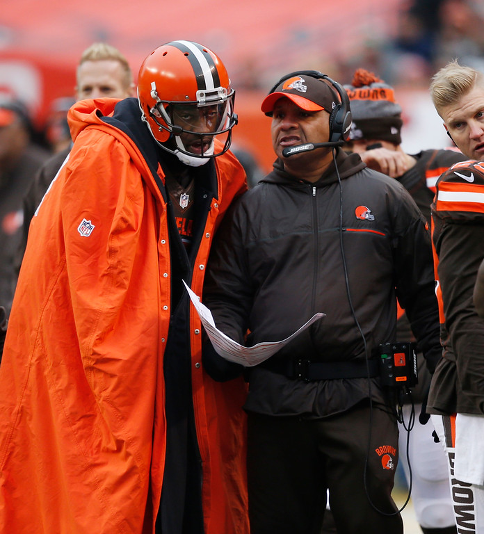 . Cleveland Browns head coach Hue Jackson, right, talks with quarterback Robert Griffin III in the first half of an NFL football game against the San Diego Chargers, Saturday, Dec. 24, 2016, in Cleveland. (AP Photo/Ron Schwane)