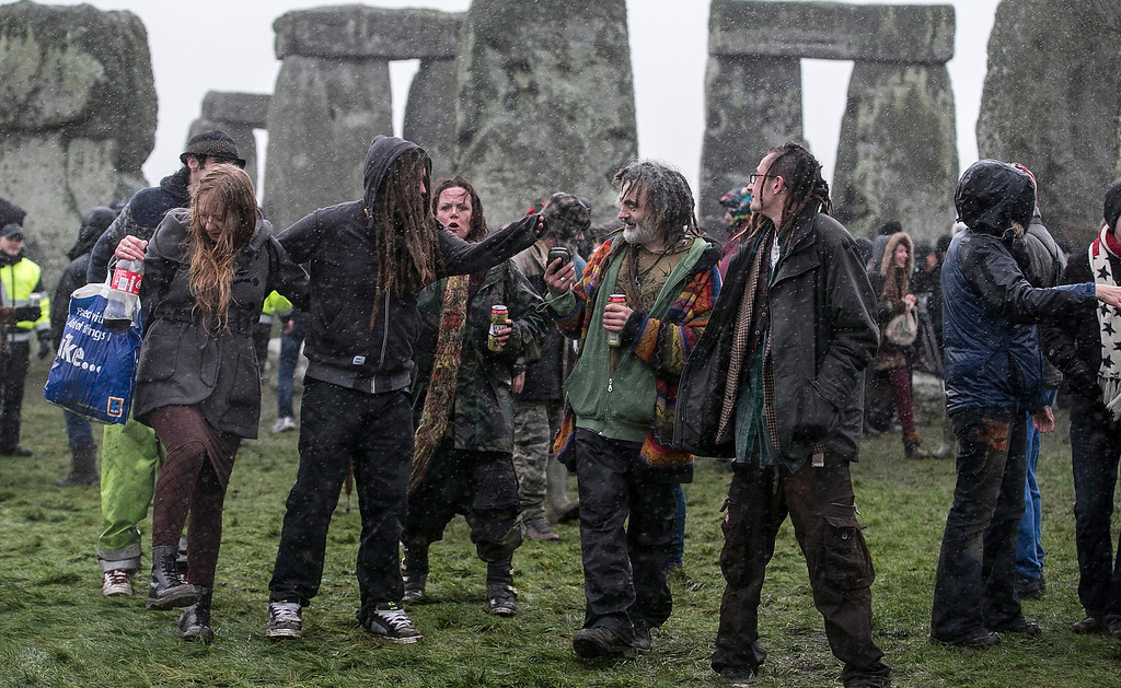. Rain falls as druids, pagans and revelers gather at Stonehenge, hoping to see the sun rise, as they take part in a winter solstice ceremony at Stonehenge on December 21, 2013 in Wiltshire, England.  (Photo by Matt Cardy/Getty Images)