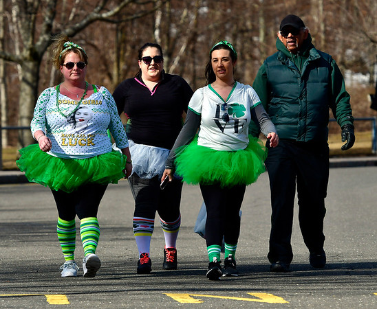 3/16/2019 MIke Orazzi | Staff Michelle Bouffard, Kim Jehning, Trista Robinson and Joe Taylor during the 2 Mile Run and the 2 Mile Fitness Walk at the 17th Annual Shamrock Run & Walk at Chippens Hill Middle School on Saturday in Bristol.