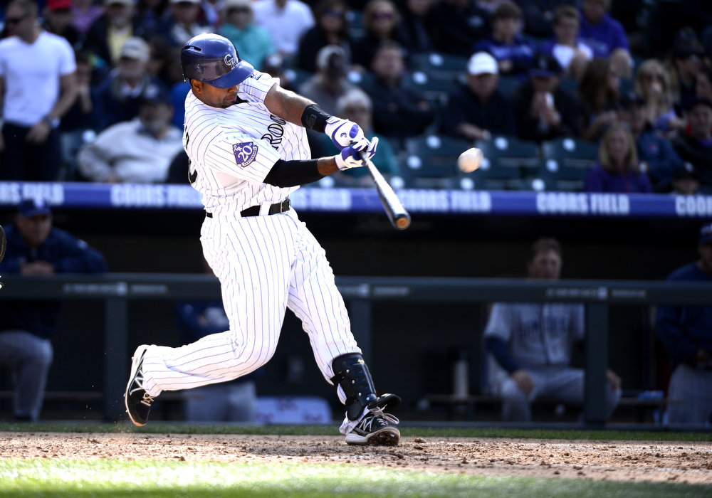 . Colorado Rockies Wilin Rosario (20) belts a three run home run in the 7th inning against the San Diego Padres April 7, 2013 at Coors Field. (Photo By John Leyba/The Denver Post)