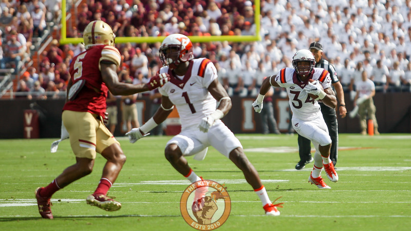 RB Travon McMillian (34) runs the ball with WR Isaiah Ford (1) blocking in front for him. (Mark Umansky/TheKeyPlay.com)