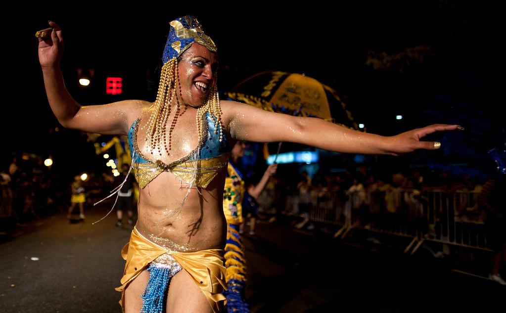 ". A member of the murga \""Los amantes de La Boca\"" performs during carnival celebrations in Buenos Aires, Argentina, Saturday, Feb. 2, 2013. (AP Photo/Natacha Pisarenko)"