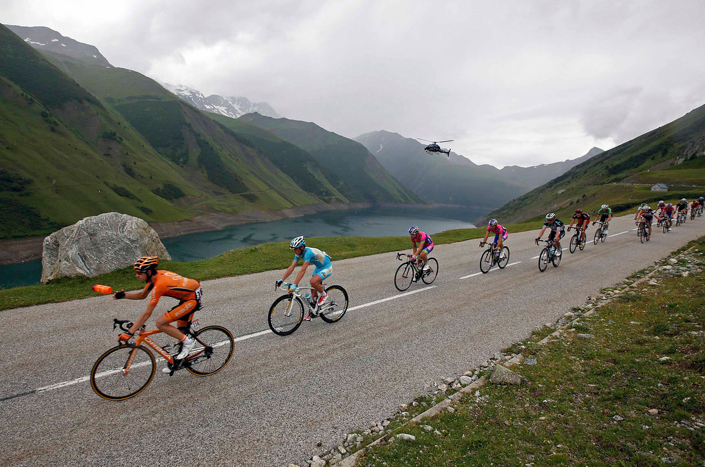 . A break away group of riders cycle during the 204.5 km nineteenth stage of the centenary Tour de France cycling race from Bourg d\'Oisans to Le Grand Bornand, in the French Alps, July 19, 2013.   REUTERS/Jacky Naegelen (