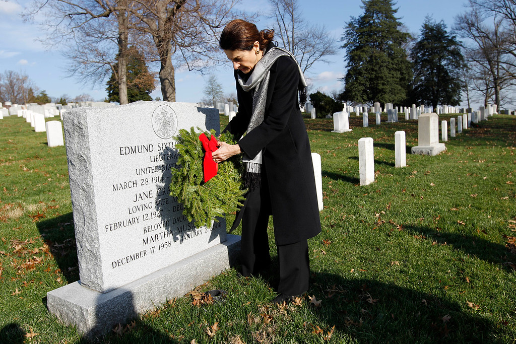 . Sen. Olympia Snowe R-Maine lays a holiday wreaths over the grave of Lieutenant Edmund Sixtus Muskie at Arlington National Cemetery in Washington Saturday Dec. 10, 2011, during Wreaths Across America Day.  (AP Photo/Jose Luis Magana)