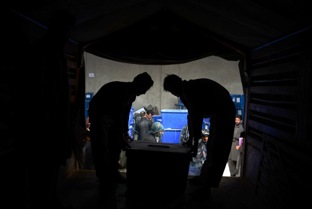 . Afghan election workers load a truck with election material at a warehouse in Mazar-i-Sharif before it was sent to different polling stations around Balkh province in northern Afghanistan on April 1, 2014.  Afghanistan will vote on April 5 to choose a successor to President Hamid Karzai and to decide the make-up of 34 provincial councils in elections seen as a benchmark of progress since the Taliban were ousted from power in 2001. Eight candidates are running in the April 5 presidential election, with a second round run-off between the two leading contenders expected in late May.  (FARSHAD USYAN/AFP/Getty Images)
