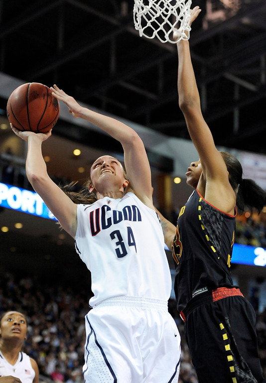 . Connecticut guard Kelly Faris (34) shoots against Maryland center Alicia DeVaughn, right, during the first half of a women\'s NCAA college regional semifinal basketball game in Bridgeport, Conn., Saturday, March 30, 2013. (AP Photo/Jessica Hill)