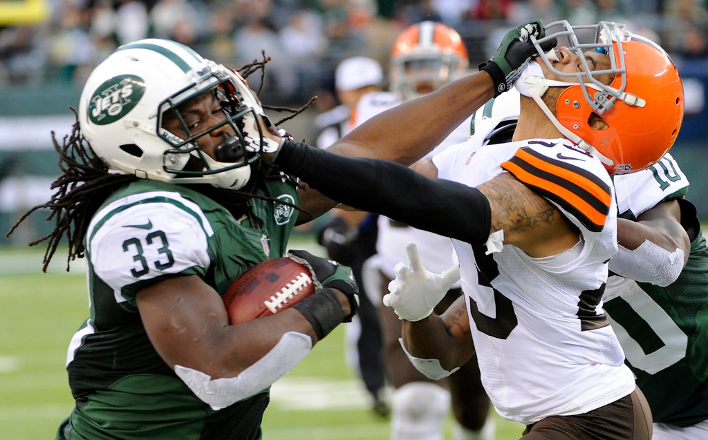 . onNew York Jets running back Chris Ivory (33) stiff-arms Cleveland Browns\' Joe Haden (23) during the second half of an NFL football game on Sunday, Dec. 22, 2013, in East Rutherford, N.J. (AP Photo/Bill Kostroun)