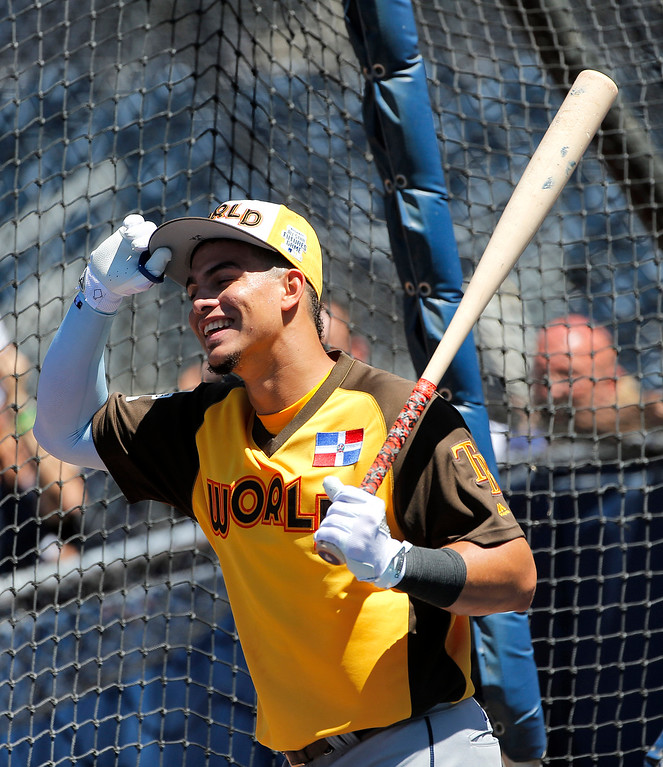 . World Team\'s Willy Adames (12), of the Tampa Bay Rays, prepares to hit prior to the All-Star Futures baseball game against the U.S. Team, Sunday, July 10, 2016, in San Diego. (AP Photo/Lenny Ignelzi)
