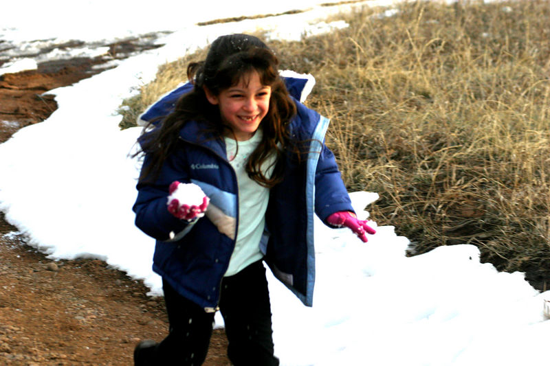 Anisa on the warpath attacking her brother with snowballs.