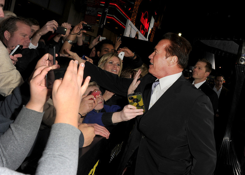 ". Actor Arnold Schwarzenegger arrives at the premiere of Lionsgate Films\' ""The Last Stand\"" at Grauman\'s Chinese Theatre on January 14, 2013 in Hollywood, California.  (Photo by Kevin Winter/Getty Images)"