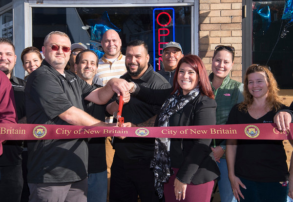 10/28/19 Wesley Bunnell | Staff A ribbon cutting was held for the grand opening of A Room with a Cue located at 174 Arch St on Monday afternoon. Co-owners Bartlomiej Ligeza, L, Peter Arroyo, middle, and Adam Mercado, Mayor Erin Stewart and Ligia Mercado.