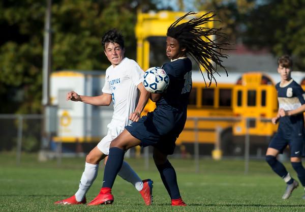 10/15/19 Wesley Bunnell | StaffrrPlainville boys soccer defeated host Newington 2-1 on Tuesday afternoon. Plainville's Trevor Rau (3) and Mannash Dalomba (18).