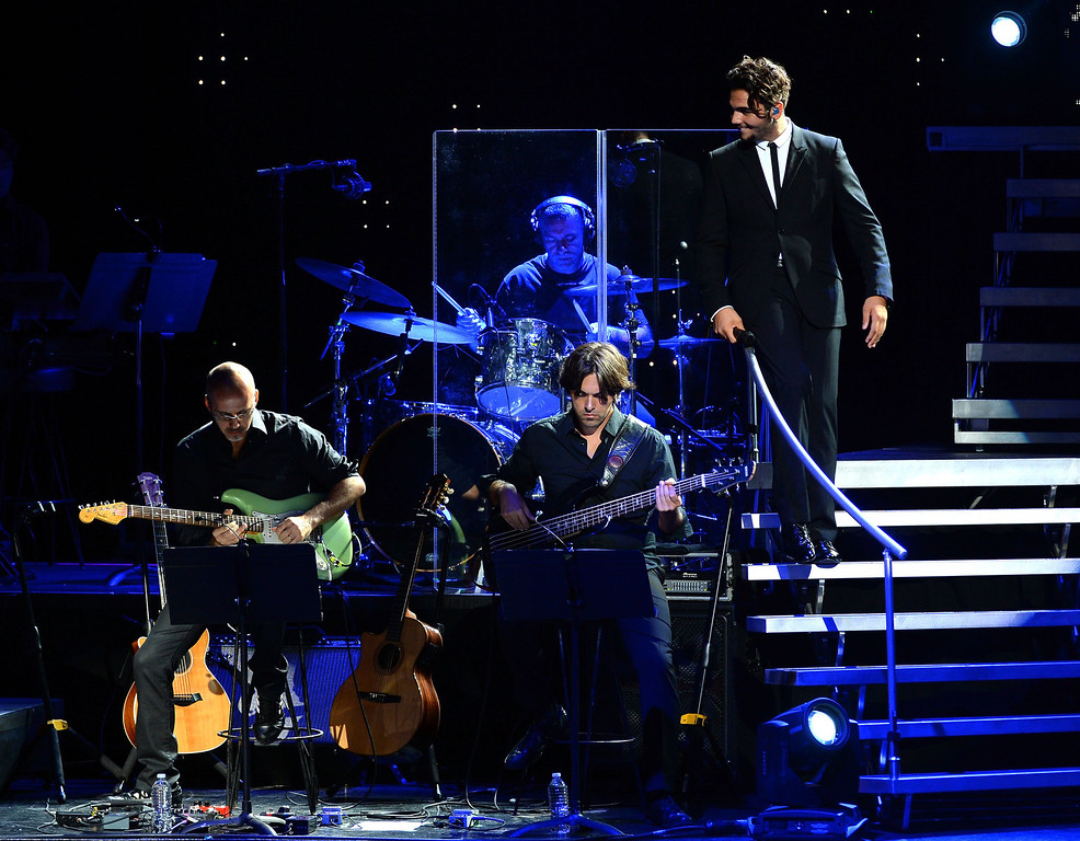 . UNIVERSAL CITY, CA - AUGUST 28:  Italian operatic pop singer Ignazio Boschetto (R) of Il Volo performs at Gibson Amphitheatre on August 28, 2013 in Universal City, California.  (Photo by Mark Davis/Getty Images)