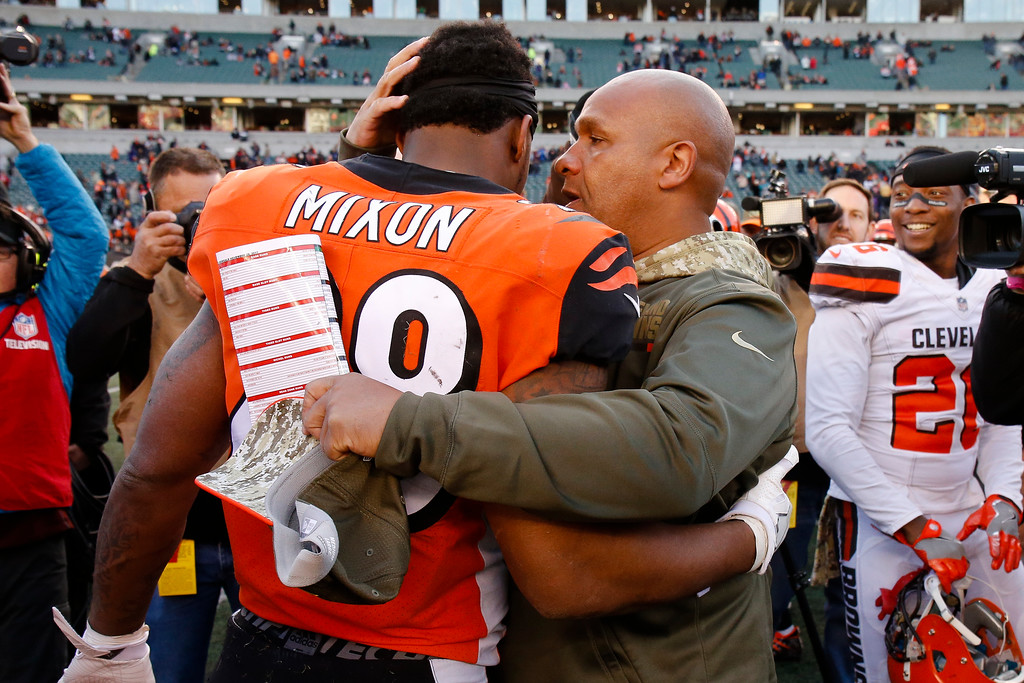 . Cleveland Browns head coach Hue Jackson, right, meets with Cincinnati Bengals running back Joe Mixon, left, after an NFL football game, Sunday, Nov. 26, 2017, in Cincinnati. (AP Photo/Gary Landers)