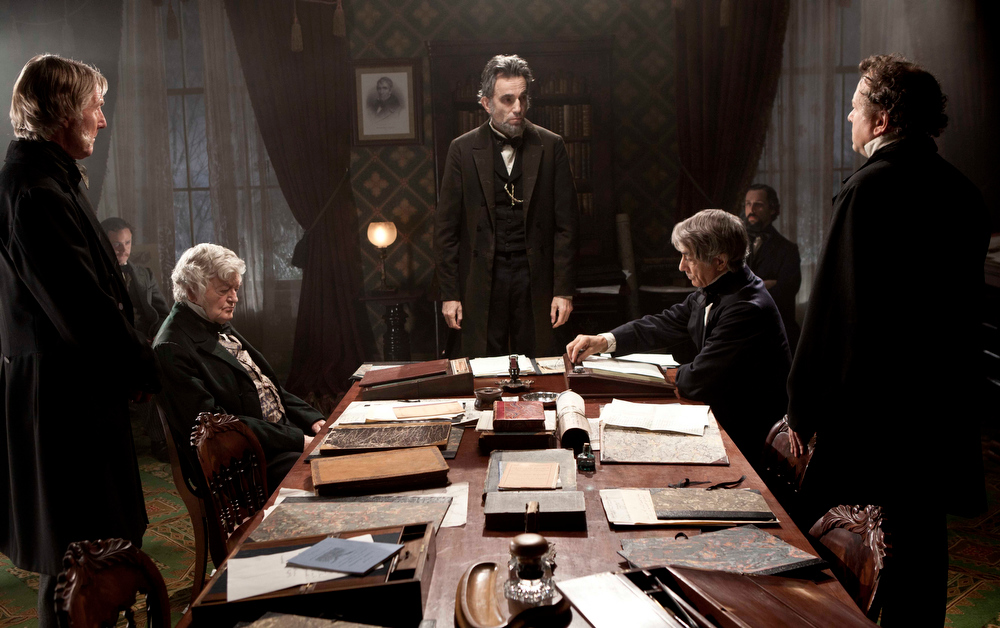 Description of . This undated publicity photo provided by DreamWorks and Twentieth Century Fox shows Daniel Day-Lewis, center, as Abraham Lincoln in a scene from the film
