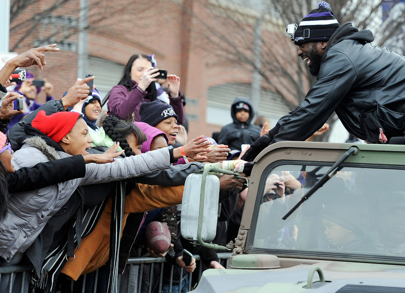 . Baltimore Ravens safety Ed Reed greets fans celebrating the NFL football team\'s Super Bowl championship during a parade in Baltimore on Tuesday, Feb. 5, 2013. The Ravens defeated the San Francisco 49ers 34-31 in New Orleans on Sunday. (AP Photo/Steve Ruark)