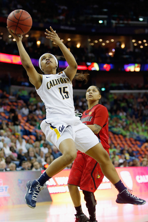 . Brittany Boyd #15 of the California Golden Bears shoots the ball over Monique Reid #33 of the Louisville Cardinals during the National Semifinal game of the 2013 NCAA Division I Women\'s Basketball Championship at the New Orleans Arena on April 7, 2013 in New Orleans, Louisiana.  (Photo by Chris Graythen/Getty Images)
