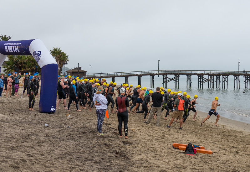 The first wave of swimmers heading out