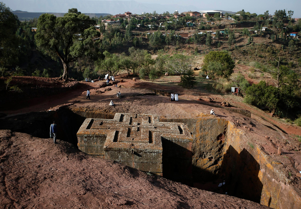 . A man stands above the Bet Medhane Alem rock church during an Orthodox Good Friday celebration in Lalibela, May 3, 2013. REUTERS/Goran Tomasevic