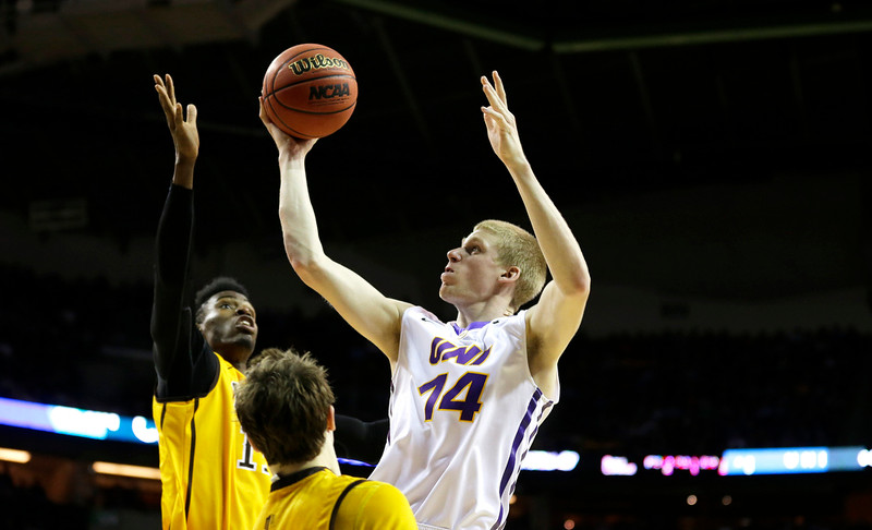 . Northern Iowa forward Nate Buss (14) shoots over Wyoming\'s Derek Cooke Jr., left, during the second half of an NCAA tournament college basketball game in the Round of 64 in Seattle, Friday, March 20, 2015. Northern Iowa beat Wyoming 71-54. (AP Photo/Ted S. Warren)