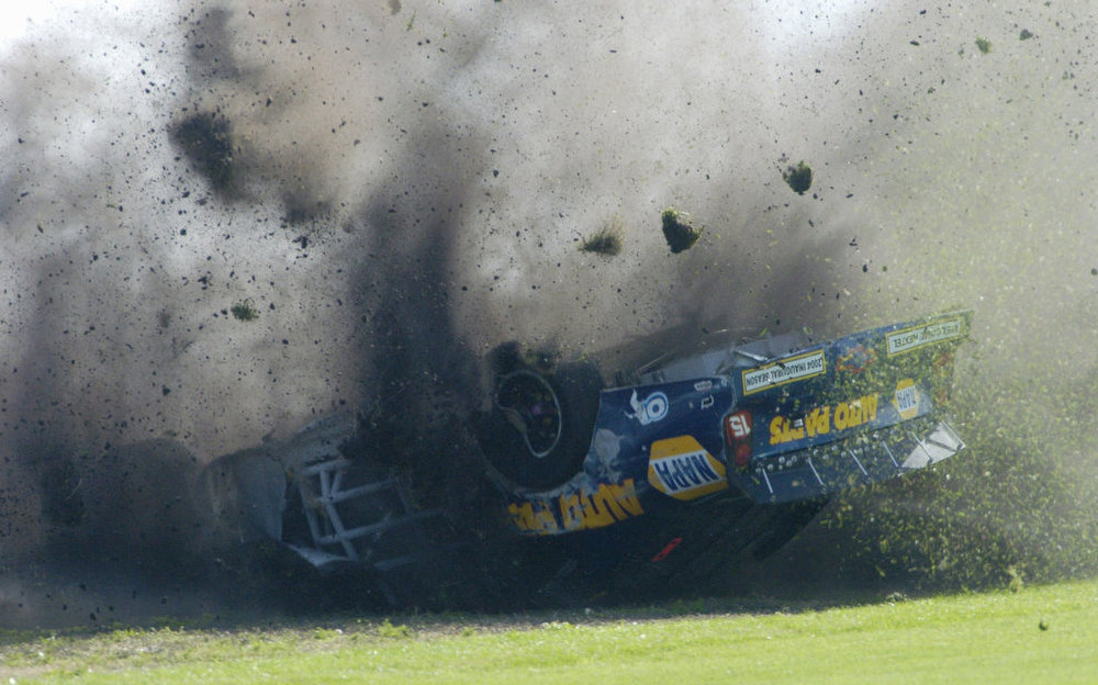 Description of . Chevrolet 15,  driven by Michael Waltrip, turns over during the Daytona 500 race Sunday,  Feb. 15, 2004, at the Daytona International Speedway in Daytona Beach, Fla.  (AP Photo/Greg Suvino)
