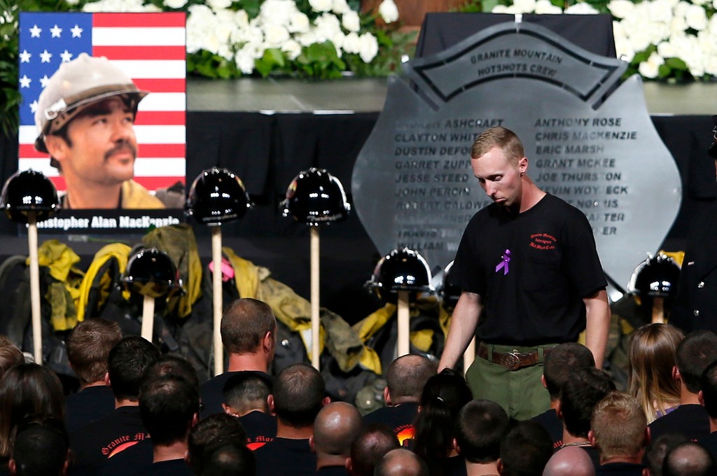 . Surviving Hotshot crew member Brendan McDonough walks back to his seat after speaking at a memorial service for the fallen members of the Granite Mountain Hotshots, in Prescott Valley, Arizona July 9, 2013.   REUTERS/Lucy Nicholson