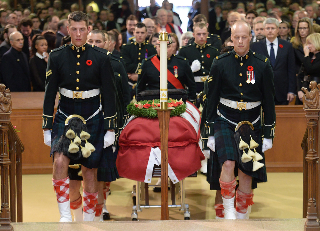 . The casket of Cpl. Nathan Cirillo is carried by pallbearers at his regimental funeral service in Hamilton, Ontario,  on Tuesday, Oct. 28, 2014. (AP Photo/The Canadian Press, Nathan Denette)