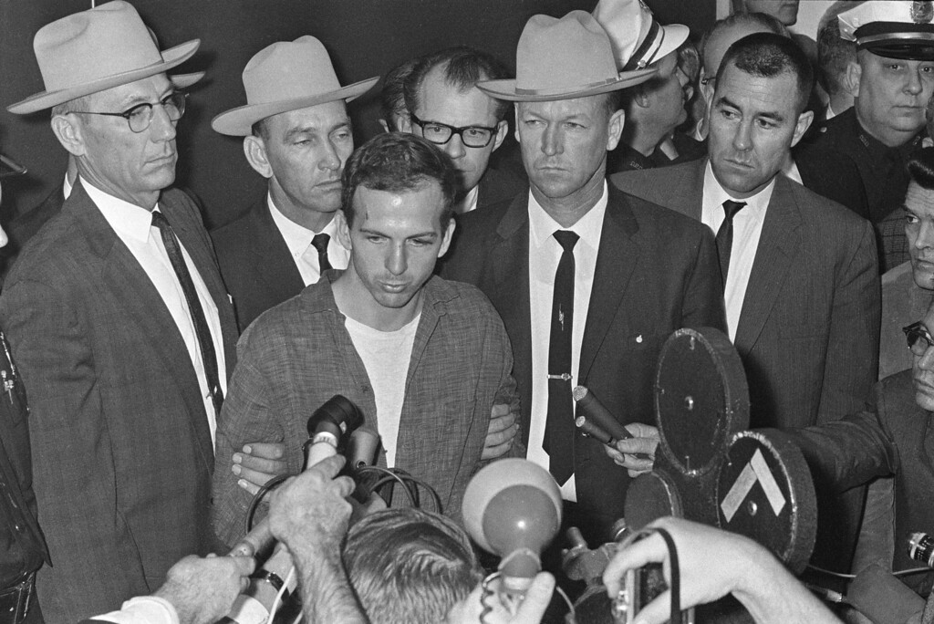 """. Lee Harvey Oswald is shown early Nov. 23, 1963, as he stood before newsmen in a Dallas police station where he repeatedly denied that he had assassinated President Kennedy yesterday.  \""""I did not kill President Kennedy,\"""" he said. \""""I did not kill anyone. I don\'t know what this is all about.\"""" He was brought before the newsmen just after formal charges of murder were filed against him.   (AP Photo)"""