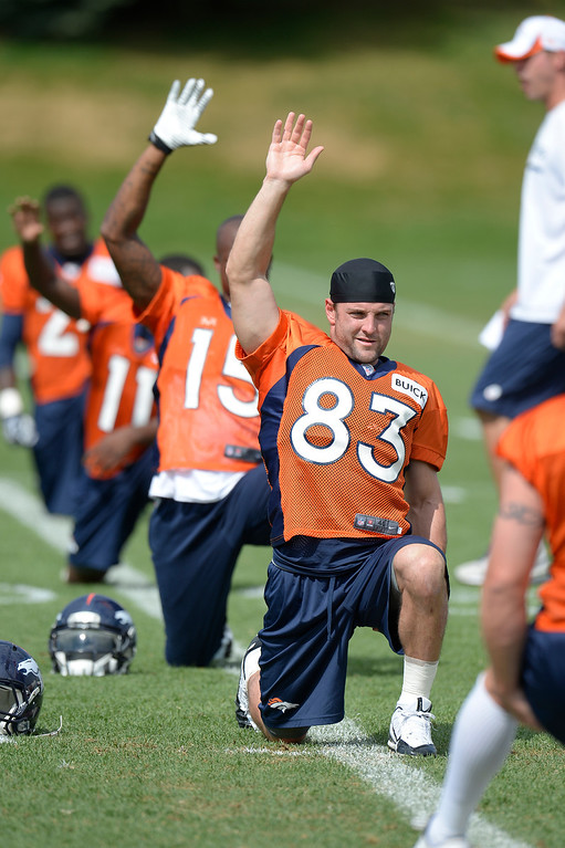 . Denver Broncos wide receiver Wes Welker (83) stretches during practice August 23, 2013 at Dove Valley (Photo by John Leyba/The Denver Post)
