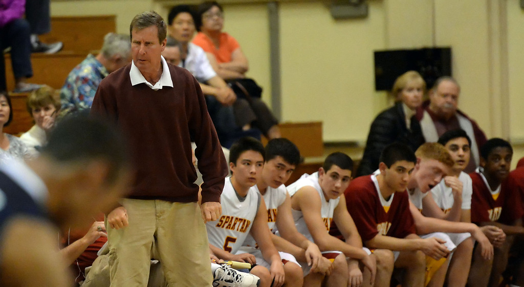 . La Canada head coach Tom Hofman reacts in the first half as they defeated La Salle 73-62 for coach Hofman\'s 600th win during a prep basketball game at La Canada High School in La Canada, Calif., on Friday, Jan. 10, 2014. Hofman record is 600 wins and 186 losses since becoming varsity head coach in the 1986-87 season. (Keith Birmingham Pasadena Star-News)