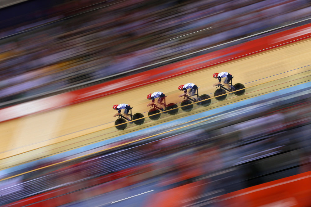 ". Geraint Thomas, Steven Burke, Edward Clancy, and Peter Kennaugh of Great Britain post a new world record time during Men\'s Team Pursuit Track Cycling Qualifying on Day 6 of the London 2012 Olympic Games at Velodrome on August 2, 2012 in London, England. ""Olympics 2012\"" ranked as Google\'s third most searched trending event of 2012. (Photo by Cameron Spencer/Getty Images)"
