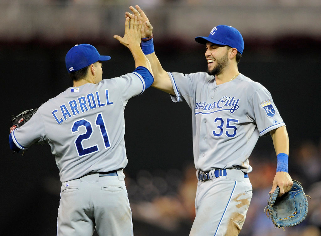 . Jamey Carroll #21 and Eric Hosmer #35 of the Kansas City Royals celebrate an 8-1  win over the Minnesota Twins on August 28, 2013 at Target Field in Minneapolis, Minnesota.. (Photo by Hannah Foslien/Getty Images)