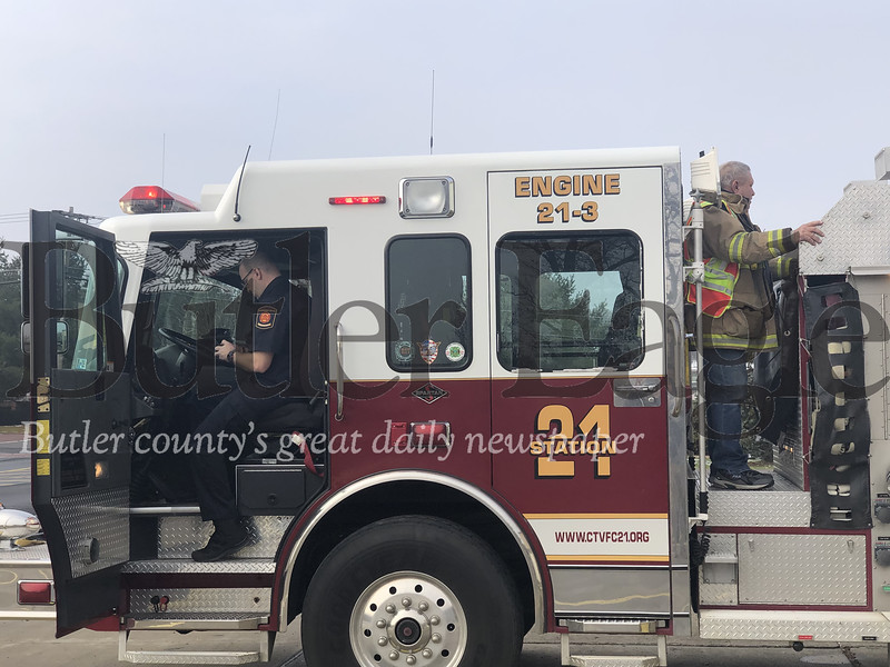 Jeff Gooch, fire risk reduction coordinator for the Cranberry Township Volunteer Fire Department, and Chuck Dohn, rear, check equipment on one the department's trucks Friday at the Haine Station.