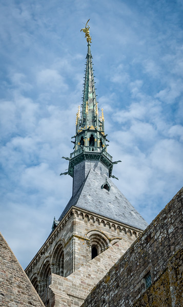 Abbey church steeple, with St. Michael at the top of the spire.  The statue, sculpted by Fremiet, was placed in 1897.