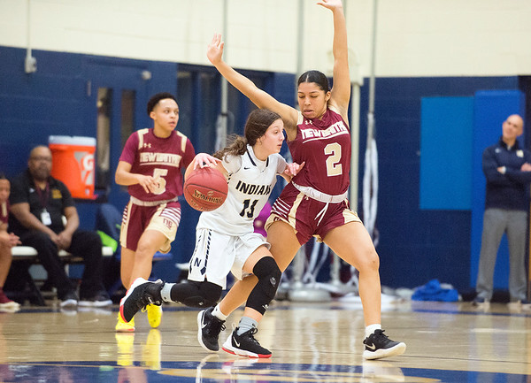 02/13/20 Wesley Bunnell | StaffrrNewington girls basketball defeated New Britain at home Thursday evening. Newington's Adriana Romano (13) guarded by Asia Gaines (2).