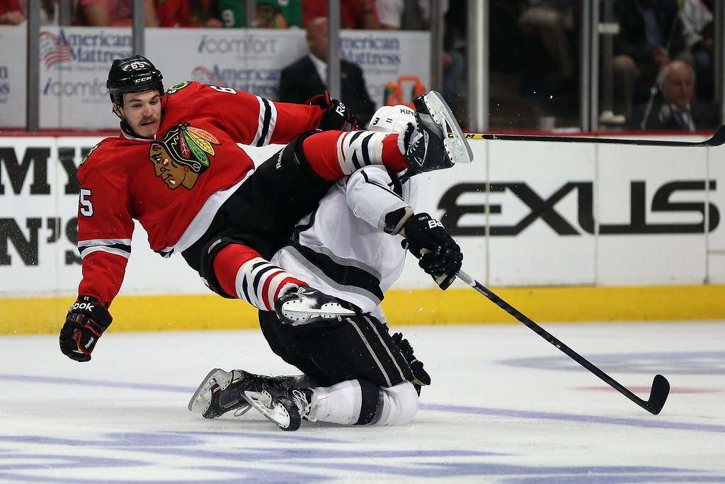 . Andrew Shaw #65 of the Chicago Blackhawks collides with Kyle Clifford #13 of the Los Angeles Kings during Game Seven of the Western Conference Final in the 2014 Stanley Cup Playoffs at United Center on June 1, 2014 in Chicago, Illinois.  (Photo by Jonathan Daniel/Getty Images)